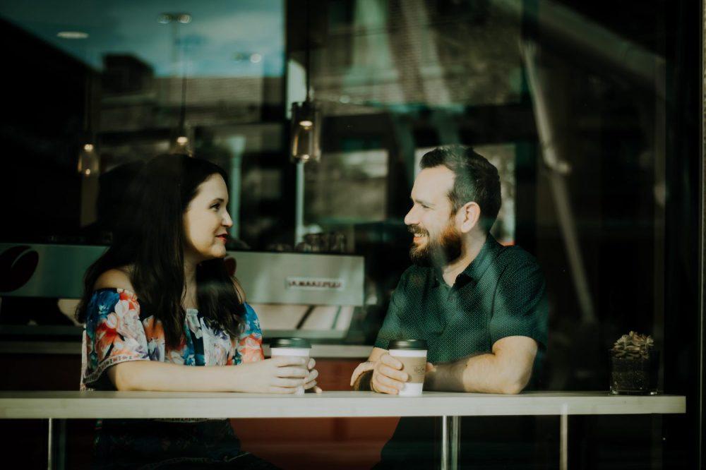 Two friends talking in a coffee shop