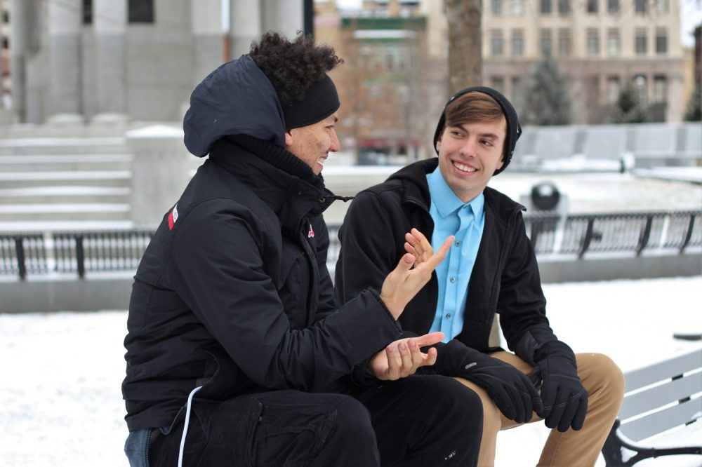 Two young people talking